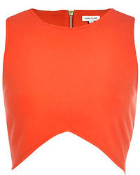 Orange shorts and a cropped top are both versatile essentials that will give your outfits a subtle modification.