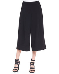 Consider teaming dark green leather heeled sandals with culottes to create a chic, glamorous look.