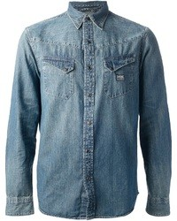 Reach for blue jeans and a denim shirt to bring out the stylish in you.