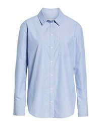 Blue fringe jeans and a button-up shirt is a good combination to carry you throughout the day.