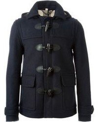 Consider pairing olive cord jeans with a duffel coat to create a smart casual look.