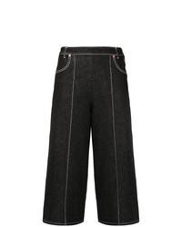 69ecc5f362 MiH Jeans Pantalones anchos vaqueros estampados negros de MiH Jeans  346  Envío gratis a Estados Unidos · Falda pantalón vaquera negra de See by Chloe