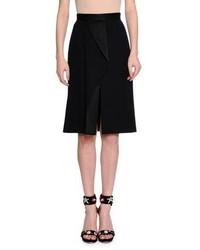Falda plisada negra de Alexander McQueen