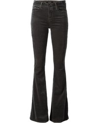 Consider pairing black chunky leather pumps with flare jeans for both chic and easy-to-wear look.