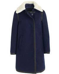 Go for a sophisticated look in navy suede ankle boots and a fur collar coat.
