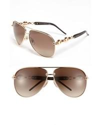 Gafas de sol en marrón y dorado