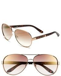 Gafas de sol en marrón y dorado de Marc by Marc Jacobs