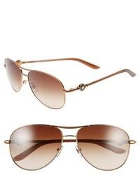 Gafas de sol en marrón y dorado de Versace