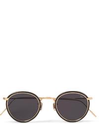 Gafas de sol en negro y dorado