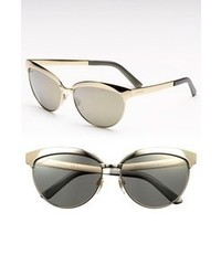 Gafas de sol en negro y dorado de Gucci
