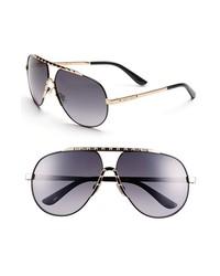 Gafas de sol en negro y dorado de Jimmy Choo