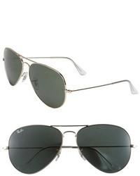 Gafas de sol en negro y dorado de Ray-Ban