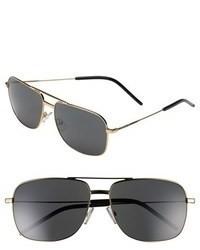 Gafas de sol en negro y dorado de Saint Laurent