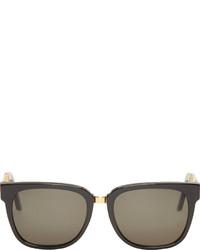 Gafas de sol en negro y dorado de Super