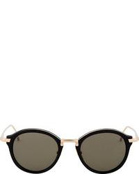 Gafas de sol en negro y dorado de Thom Browne