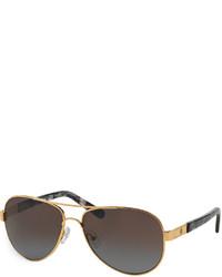 Gafas de sol en negro y dorado de Tory Burch