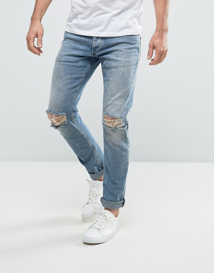 7e67a325 ... Jack and Jones Jack Jones Intelligence Slim Fit Jeans In Light Blue  Wash With Knee Rips ...
