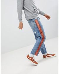 ASOS DESIGN Skater Jeans In Vintage Mid Wash With Orange Aztec