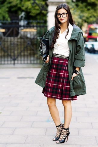 How to wear: dark green anorak, white dress shirt, red plaid a-line skirt, black leather gladiator sandals