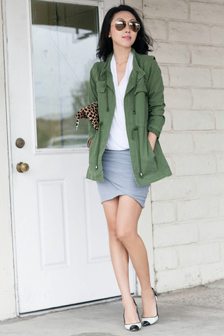 How to wear: olive anorak, white short sleeve blouse, grey mini skirt, white and black leather pumps