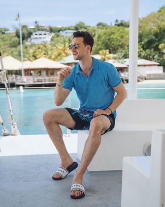 How to wear: aquamarine polo, navy print shorts, white print rubber sandals, black sunglasses