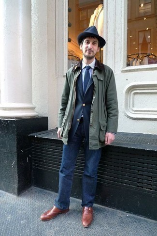 How to Wear a Dark Green Barn Jacket: Make a dark green barn jacket and navy jeans your outfit choice to feel instantly confident in yourself and look laid-back and cool. And if you want to effortlessly elevate this ensemble with a pair of shoes, why not complete this look with tobacco leather monks?