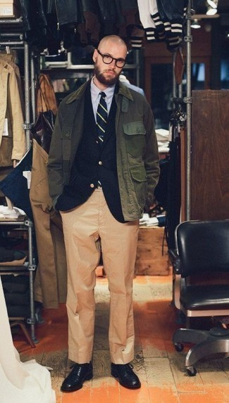 How to Wear an Olive Barn Jacket: Teaming an olive barn jacket with khaki dress pants is an on-point idea for a classic and refined ensemble. This look is finished off nicely with a pair of black leather derby shoes.