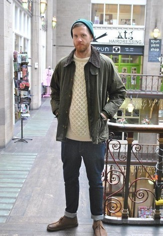 How to Wear an Olive Barn Jacket: No matter where you find yourself over the course of the day, you'll be stylishly prepared in this laid-back combination of an olive barn jacket and navy jeans. Consider brown leather desert boots as the glue that brings your outfit together.