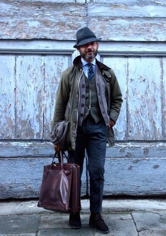 How to wear: olive barn jacket, brown cardigan, olive wool waistcoat, light blue dress shirt
