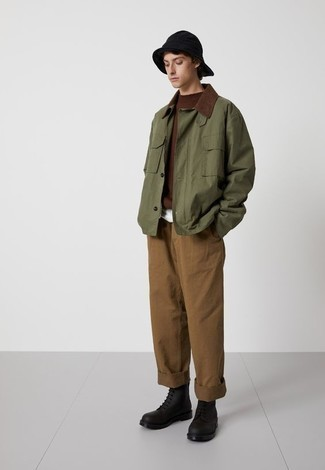 Black Leather Casual Boots Outfits For Men: If you'd like take your off-duty style game to a new level, team an olive barn jacket with brown chinos. To introduce a bit of depth to this ensemble, throw black leather casual boots in the mix.