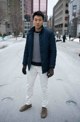 500+ Chill Weather Outfits For Men: Show off your skills in menswear styling in this laid-back combo of a navy quilted barn jacket and white jeans. For something more on the sophisticated side to complement this getup, complement this outfit with brown suede desert boots.