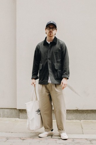 Charcoal Barn Jacket Outfits: Try pairing a charcoal barn jacket with beige chinos for both on-trend and easy-to-style look. For a more casual spin, complement this getup with white canvas low top sneakers.