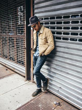 How to wear: beige barn jacket, blue denim shirt, navy skinny jeans, olive suede desert boots