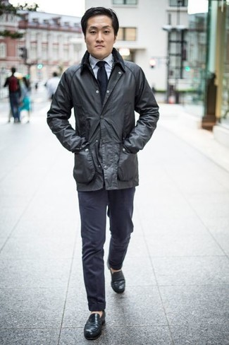 Black Barn Jacket Spring Outfits: If you enjoy functional menswear, consider wearing a black barn jacket and navy chinos. A pair of black leather loafers immediately bumps up the classy factor of this ensemble. A look like this is ideal for winter-to-spring weather.