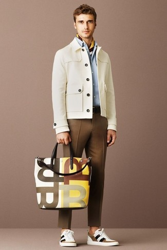 How to wear: beige barn jacket, light blue dress shirt, brown dress pants, white and brown low top sneakers