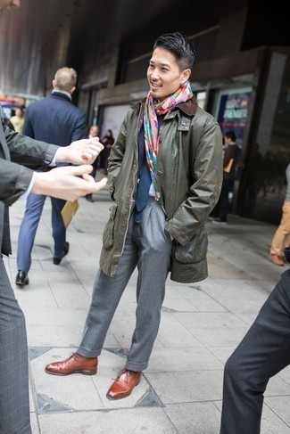 How to Wear a Navy Knit Scarf For Men: An olive barn jacket and a navy knit scarf are an edgy combination that every style-conscious gentleman should have in his casual styling rotation. Finishing with brown leather derby shoes is the simplest way to add a bit of flair to your getup.