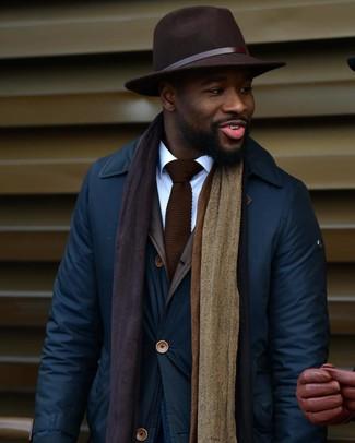 How to wear: navy barn jacket, white dress shirt, dark brown wool hat, dark brown knit tie