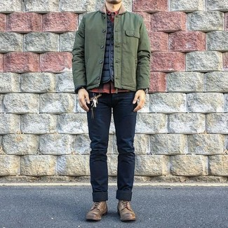 How to wear: olive barn jacket, black quilted gilet, red and black check long sleeve shirt, navy skinny jeans