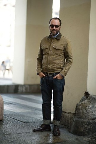 How to Wear Jeans For Men: Marry a tan barn jacket with jeans to put together an interesting and modern-looking laid-back outfit. Add a different twist to this look by sporting dark brown leather derby shoes.