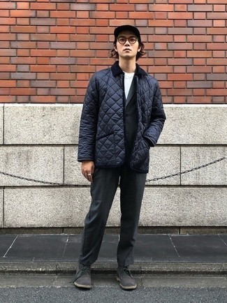 Charcoal Suit Smart Casual Outfits: We're loving the way this pairing of a charcoal suit and a navy quilted barn jacket immediately makes a man look sophisticated and stylish. Loosen things up and complement your look with a pair of charcoal suede desert boots.