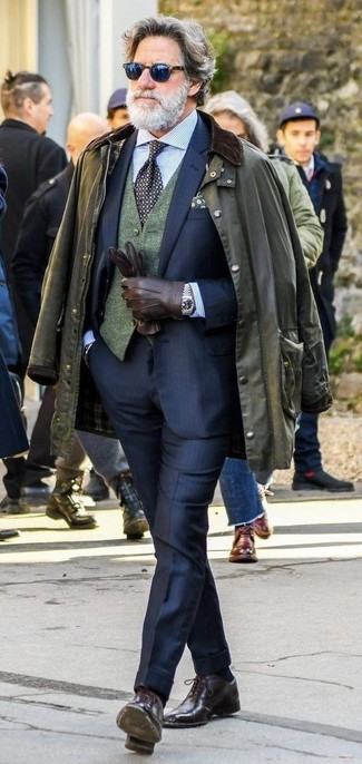 How to wear: olive barn jacket, navy suit, dark green wool waistcoat, light blue vertical striped dress shirt