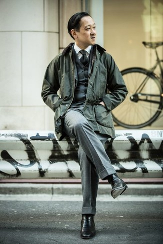 How to Wear a Black Tie For Men: A modern gent's elegant collection should always include such mainstays as a dark green barn jacket and a black tie. Introduce a pair of black leather chelsea boots to the mix and ta-da: the look is complete.