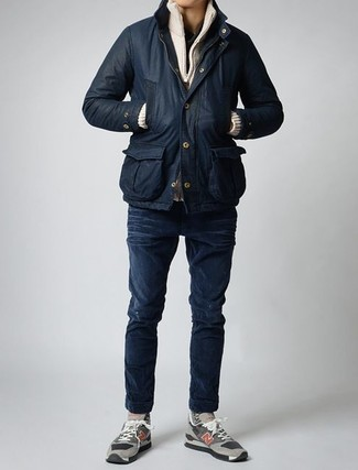 How to wear: black barn jacket, beige zip sweater, black henley shirt, navy skinny jeans