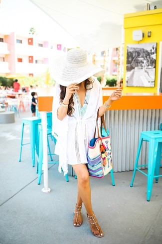 How to wear: white beach dress, mint print swimsuit, beige studded leather thong sandals, white embroidered canvas tote bag