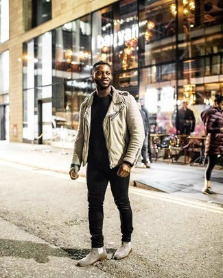 Men's Outfits 2020: A beige biker jacket and black jeans are a great combination that will take you throughout the day. For an on-trend hi-low mix, complement your look with grey suede chelsea boots.