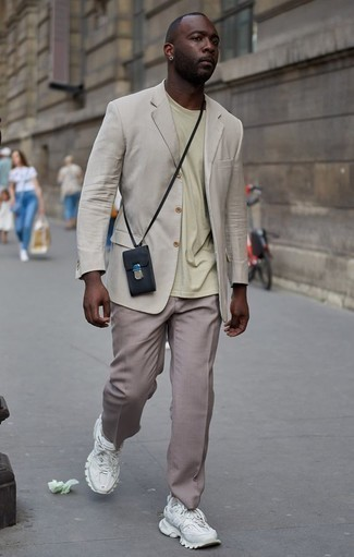 How to Wear Khaki Dress Pants For Men: This outfit demonstrates it is totally worth investing in such elegant menswear items as a beige blazer and khaki dress pants. Finishing off with a pair of white athletic shoes is a guaranteed way to add a laid-back touch to your outfit.