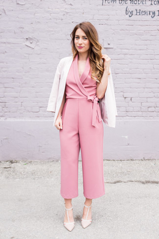 Let everyone know that you know a thing or two about style in a blazer and a pink jumpsuit. Play down the casualness of your outfit with beige leather pumps. This ensemble is the definition of perfect for those warmer springtime days.