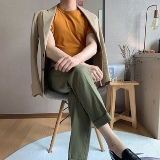Tobacco Crew-neck T-shirt Outfits For Men: Combining a tobacco crew-neck t-shirt with olive dress pants is an on-point idea for a casually sleek look. Finishing off with black leather loafers is a surefire way to breathe a dose of class into your outfit.