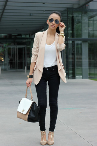 Let everyone know that you know a thing or two about style in a nude silk blazer and jeans. Add beige pumps to your look for an instant style upgrade.