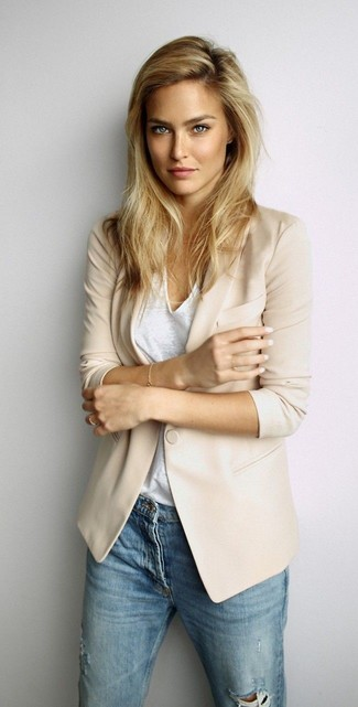 A beige blazer and blue ripped slim jeans is a versatile combination that will provide you with variety.